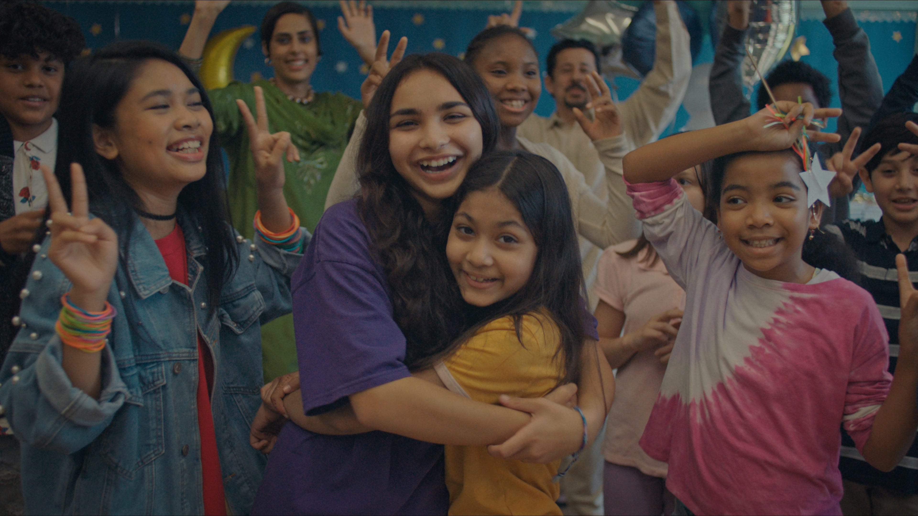 """(Center, l-r): Jenna Qureshi as Zainab and Shanessa Khawaja as Ameena in Disney's """"LAUNCHPAD"""" Season One short, """"AMERICAN EID,"""" Written and Directed byAqsa Altaf.Photo courtesy of Disney. © 2021 Disney Enterprises, Inc. All Rights Reserved."""