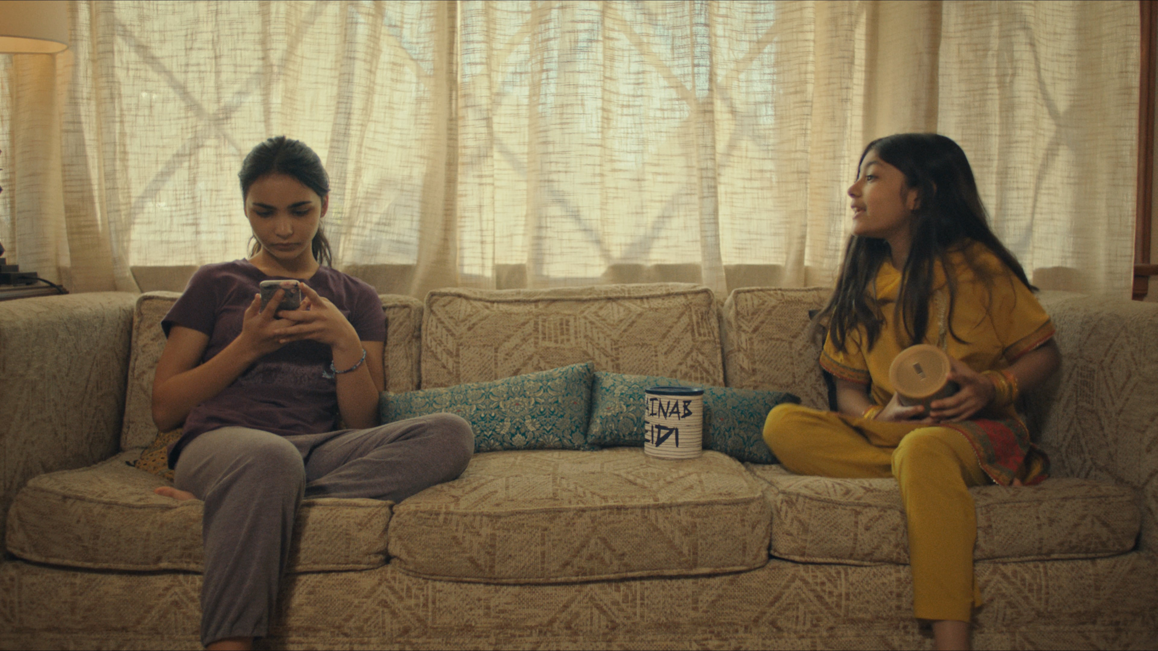 """(L-R): Jenna Qureshi as Zainab and Shanessa Khawaja as Ameena in Disney's """"LAUNCHPAD"""" Season One short, """"AMERICAN EID,"""" Written and Directed byAqsa Altaf.Photo courtesy of Disney. © 2021 Disney Enterprises, Inc. All Rights Reserved."""