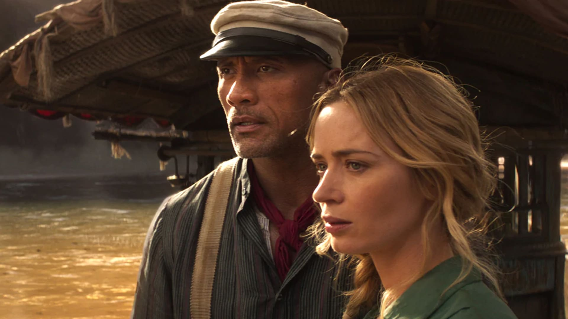 Dwayne Johnson and Emily Blunt on a riverboat in Disney's Jungle Cruise