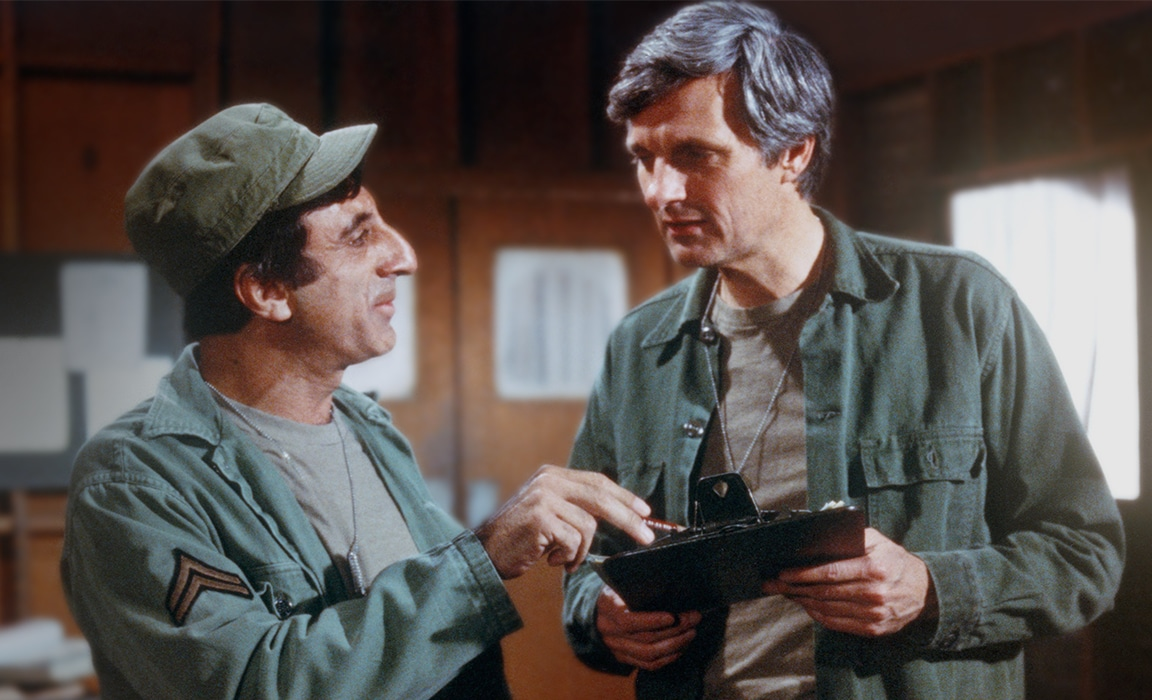 Jamie Farr and Alan Alda in M*A*S*H* on Disney Plus