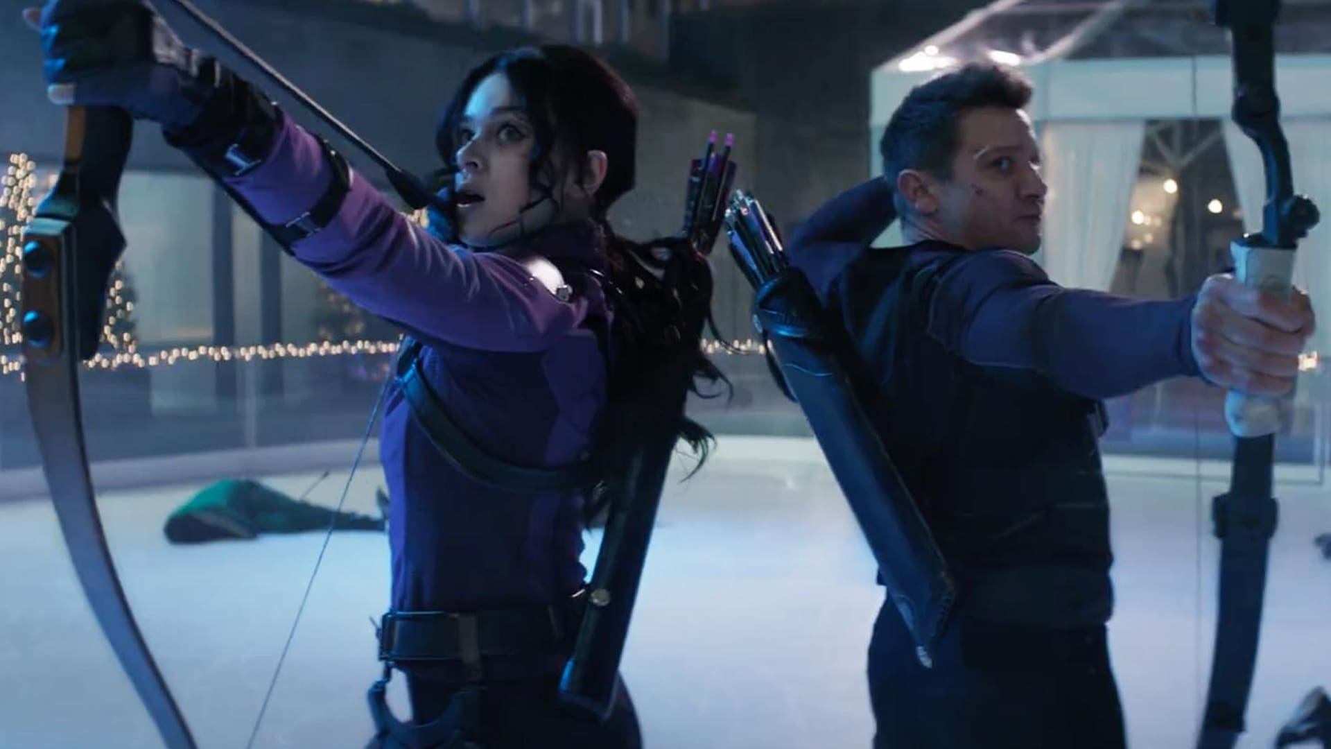 Hailee Steinfeld and Jeremy Renner with archery bows from Marvel Studios' Hawkeye