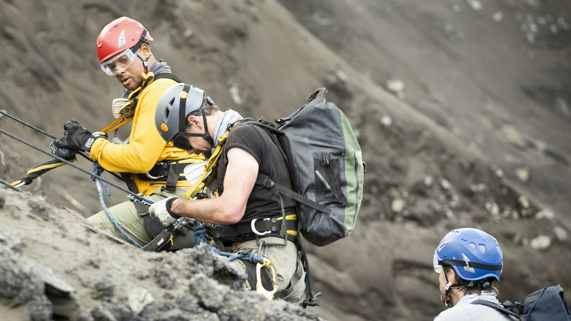 Will Smith, volcanologist Jeff Johnson and explorer Erik Weihenmayer descend into a volcano in Welcome to Earth
