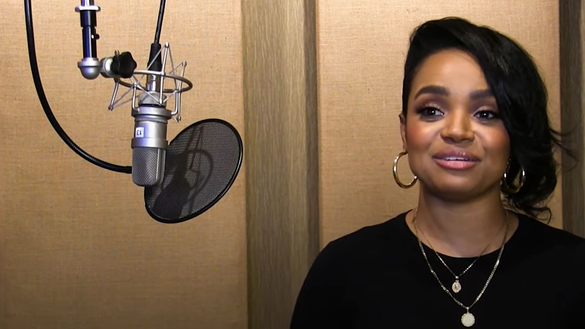 Actor and musician Kyla Pratt in a voice recording studio for the series The Proud Family: Louder and Prouder