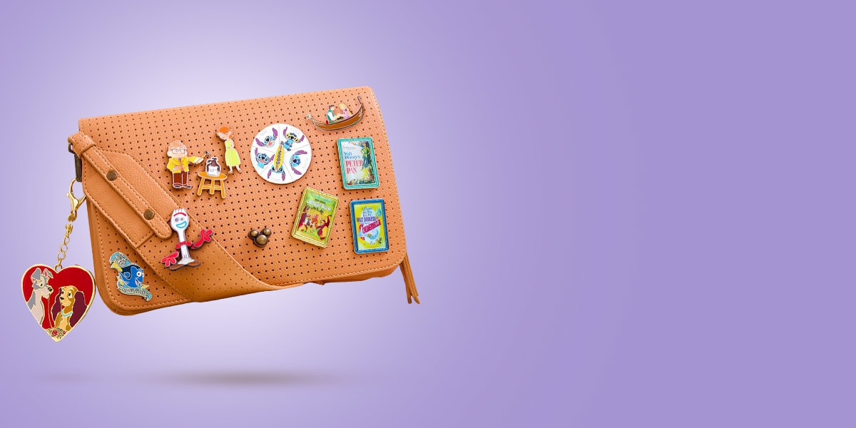 A bag with a range of flair, pins and accessories from shopDisney UK