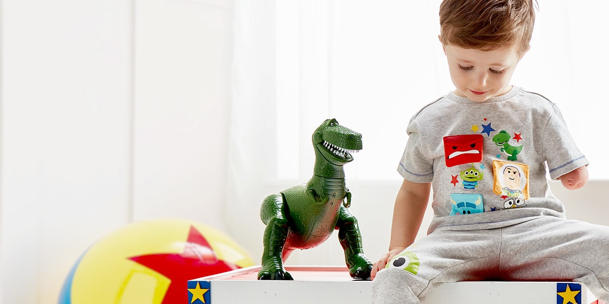 A young boy with Pixar toys from shopDisney UK
