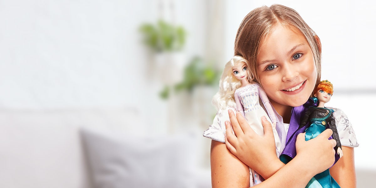 A girl holds Frozen toys from shopDisney UK.