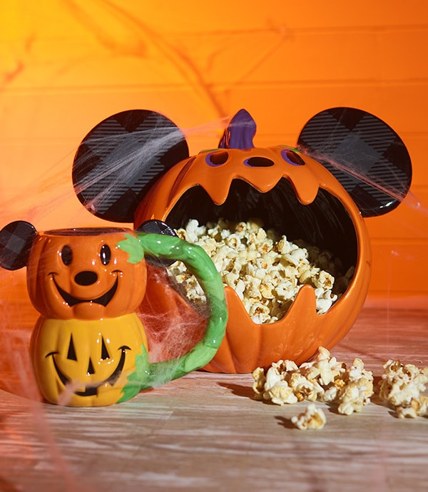 A Jack-o'-Lantern bowl filled with popcorn from shopDisney UK's Halloween collection