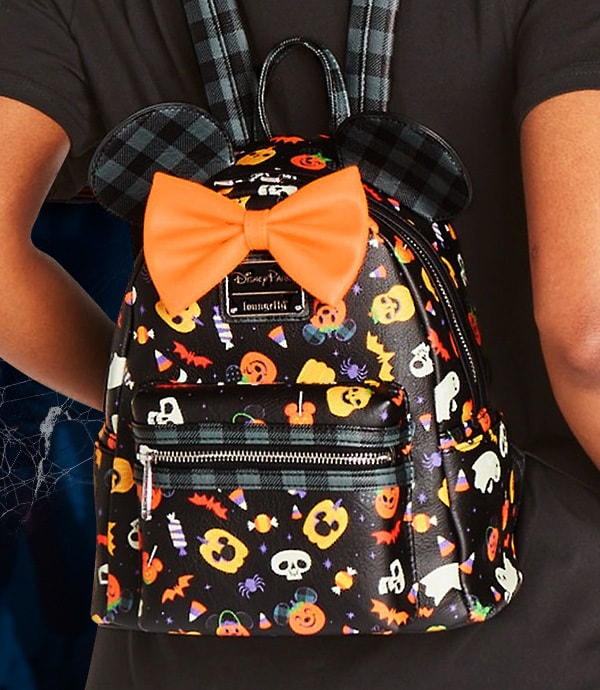 A woman wears Halloween themed backpack from shopDisney UK's Halloween collection