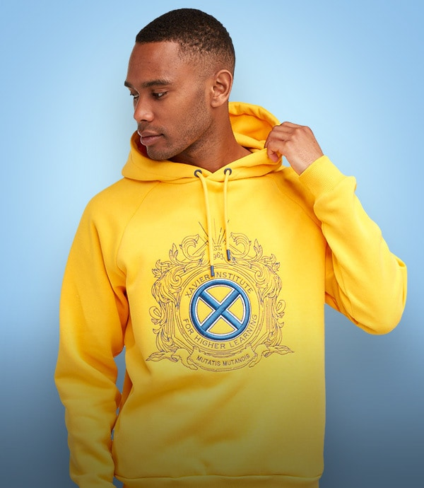 A man wears a hooded sweatshirt from the Marvel X-Men available at shopDisney UK