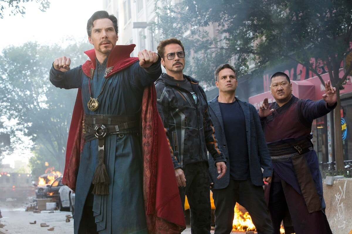 Doctor Strange, Iron Man, Bruce Banner, and Wong stand together in a scene from Avengers: Infinity War.