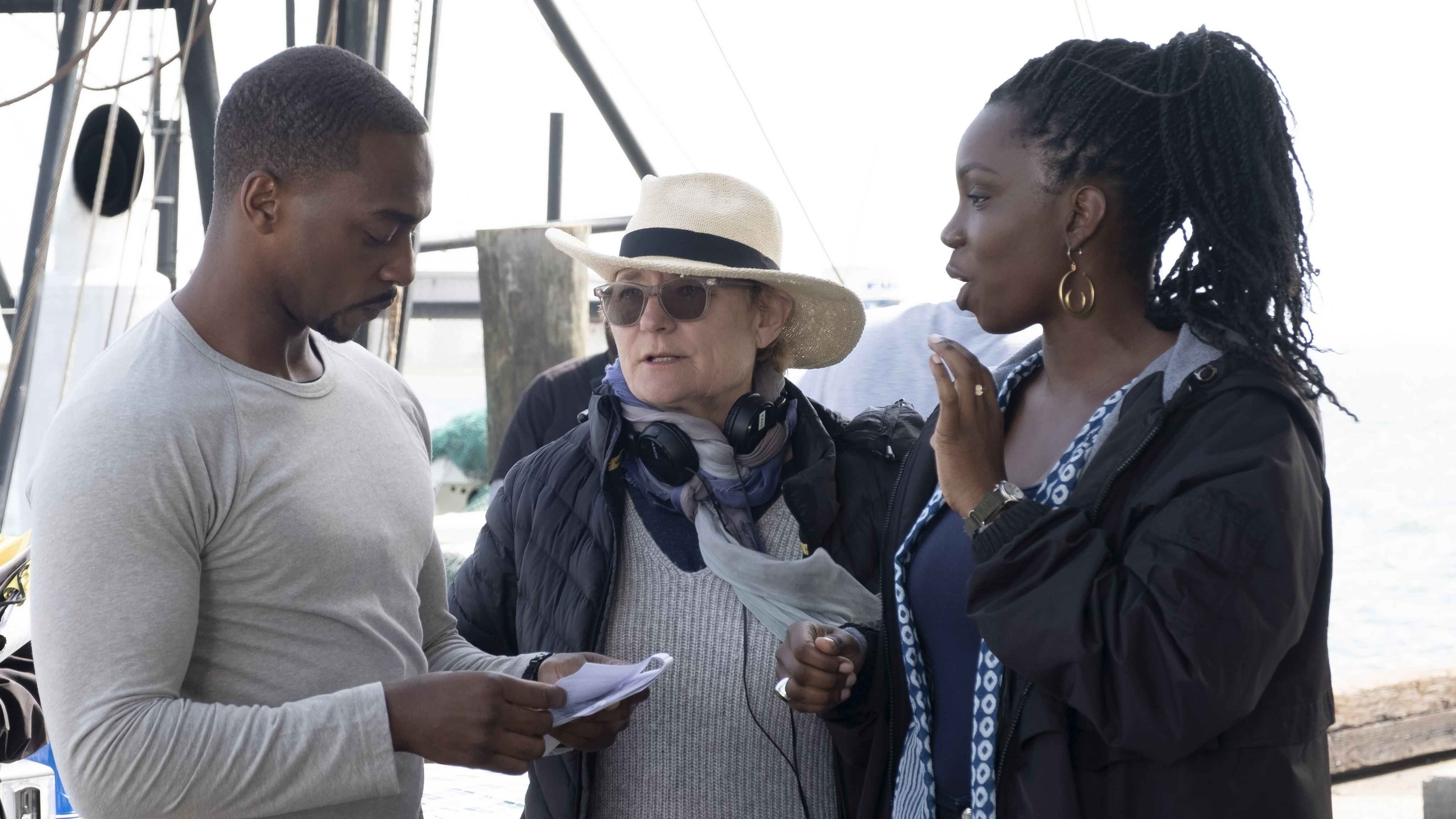 (L-R): Falcon/Sam Wilson (Anthony Mackie), Director Kari Skogland and Sarah Wilson (Adepero Oduye) on the set of Marvel Studios' THE FALCON AND THE WINTER SOLDIER exclusively on Disney+. Photo by Chuck Zlotnick. ©Marvel Studios 2021. All Rights Reserved.