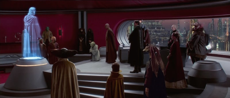 Bail Organa, prominent Senators, and Jedi Masters watching a transmission from Obi-Wan Kenobi