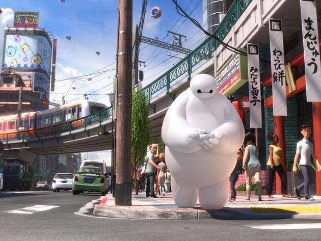 Baymax follows Hiro's MicroBots through San Fransokyo.