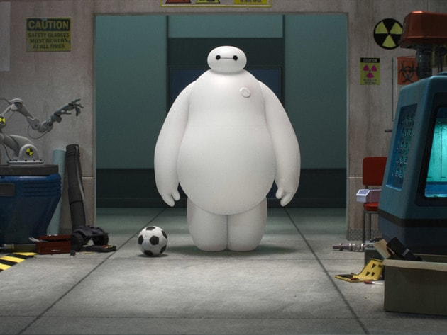 Baymax attempts to pick up a football.