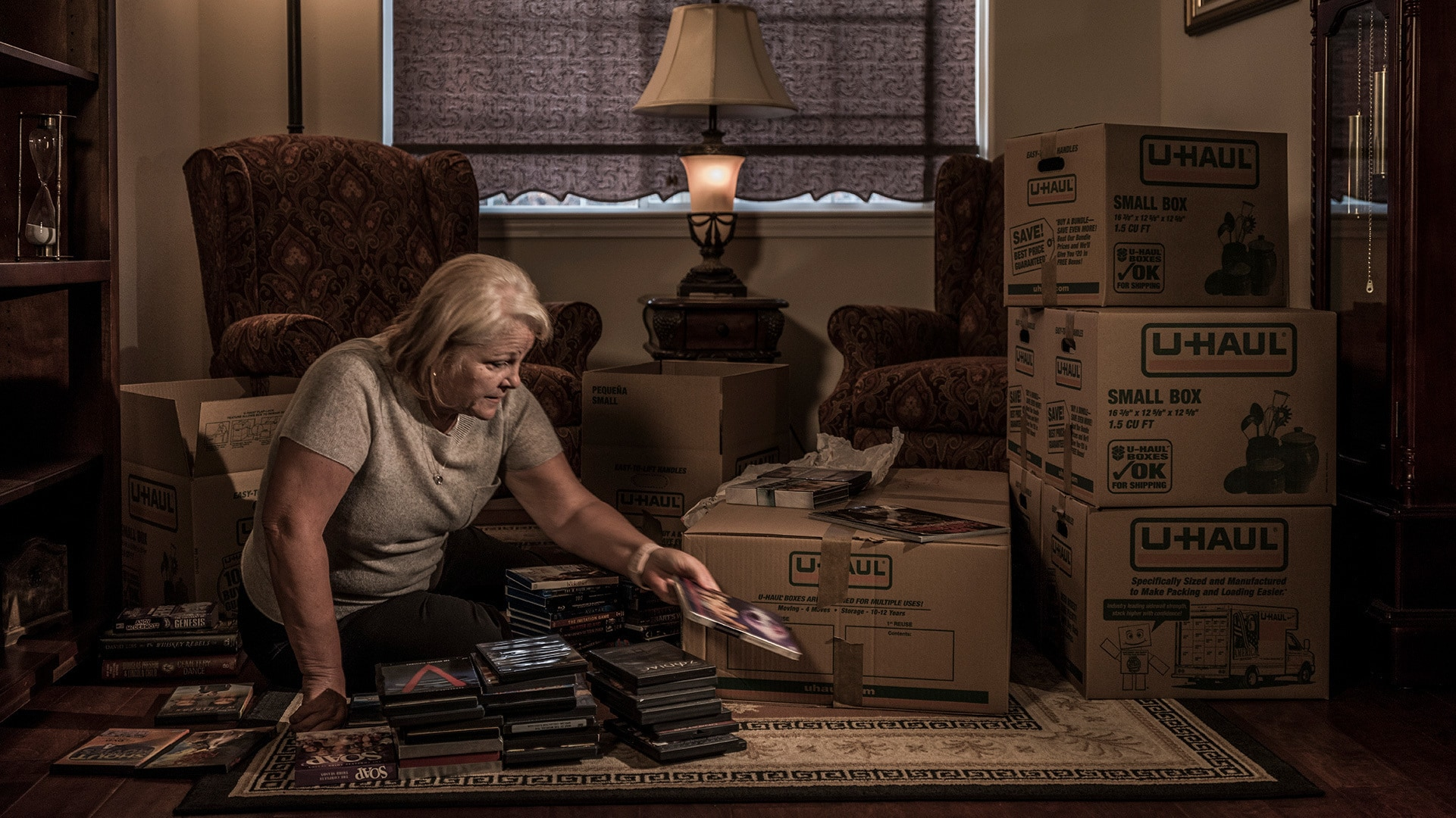 Michelle John, the emeritus superintendent of Paradise Schools, as she packs her home and prepares to move away from the town in the wake of the fire. (Photo by National Geographic/Pete Muller)
