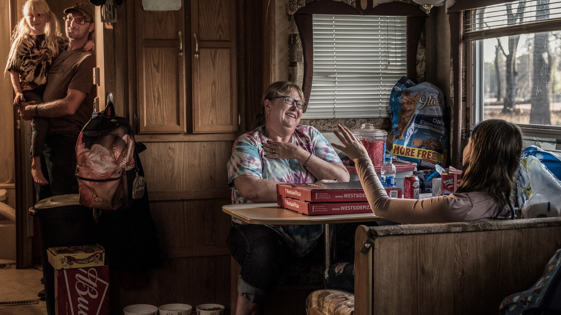Shannon Tutor and her family in their trailer in Paradise, California (National Geographic/Pete Muller)