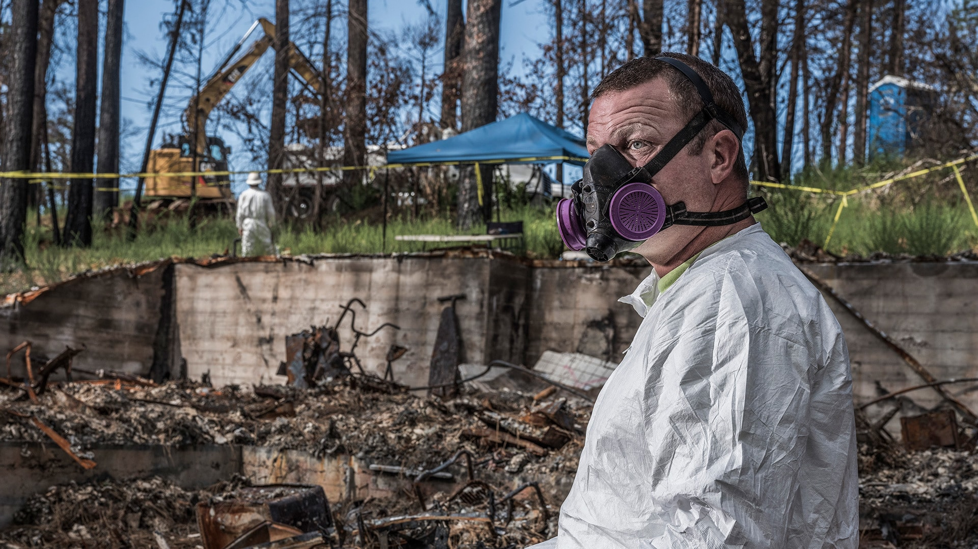 Mauny Roethler clearing debris in Paradise, California. (Photo by National Geographic/Pete Muller)