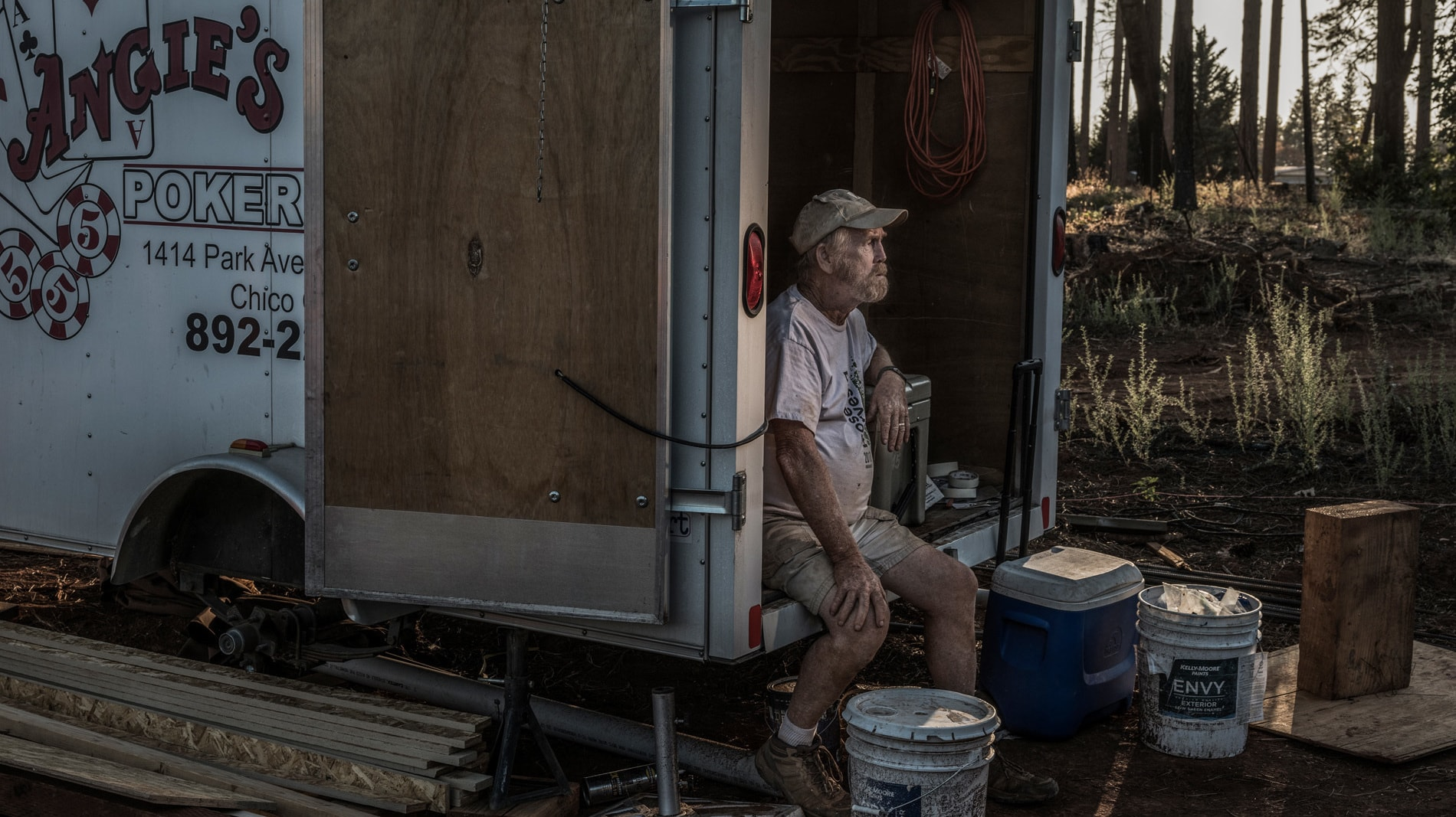 "Steve ""Woody"" Culleton sits in a small storage trailer on his property in Paradise, CA, where he is rebuilding his home. (National Geographic/Pete Muller)"