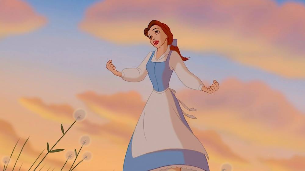 Belle singing in a field