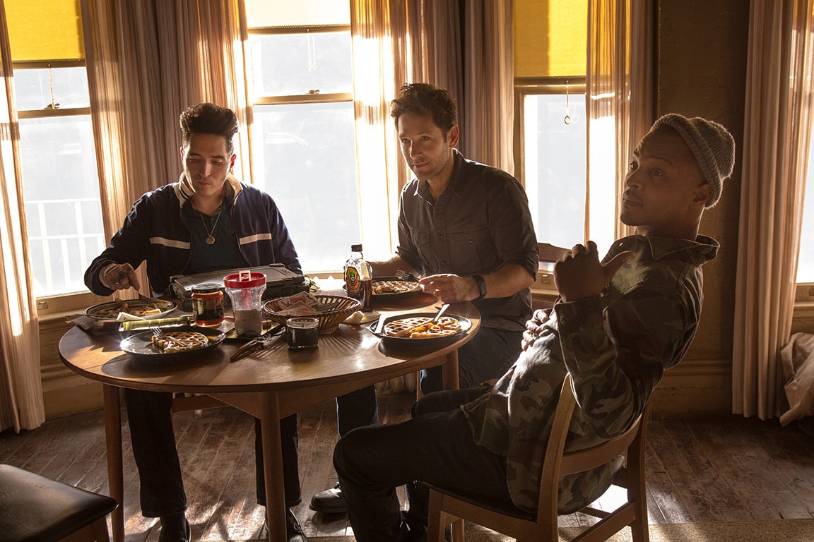 """David Dastmalchian (as Kurt), Paul Rudd (as Scott Lang) and Tip """"T.I."""" Harris (as Dave) eating at a table in the movie Ant-Man"""