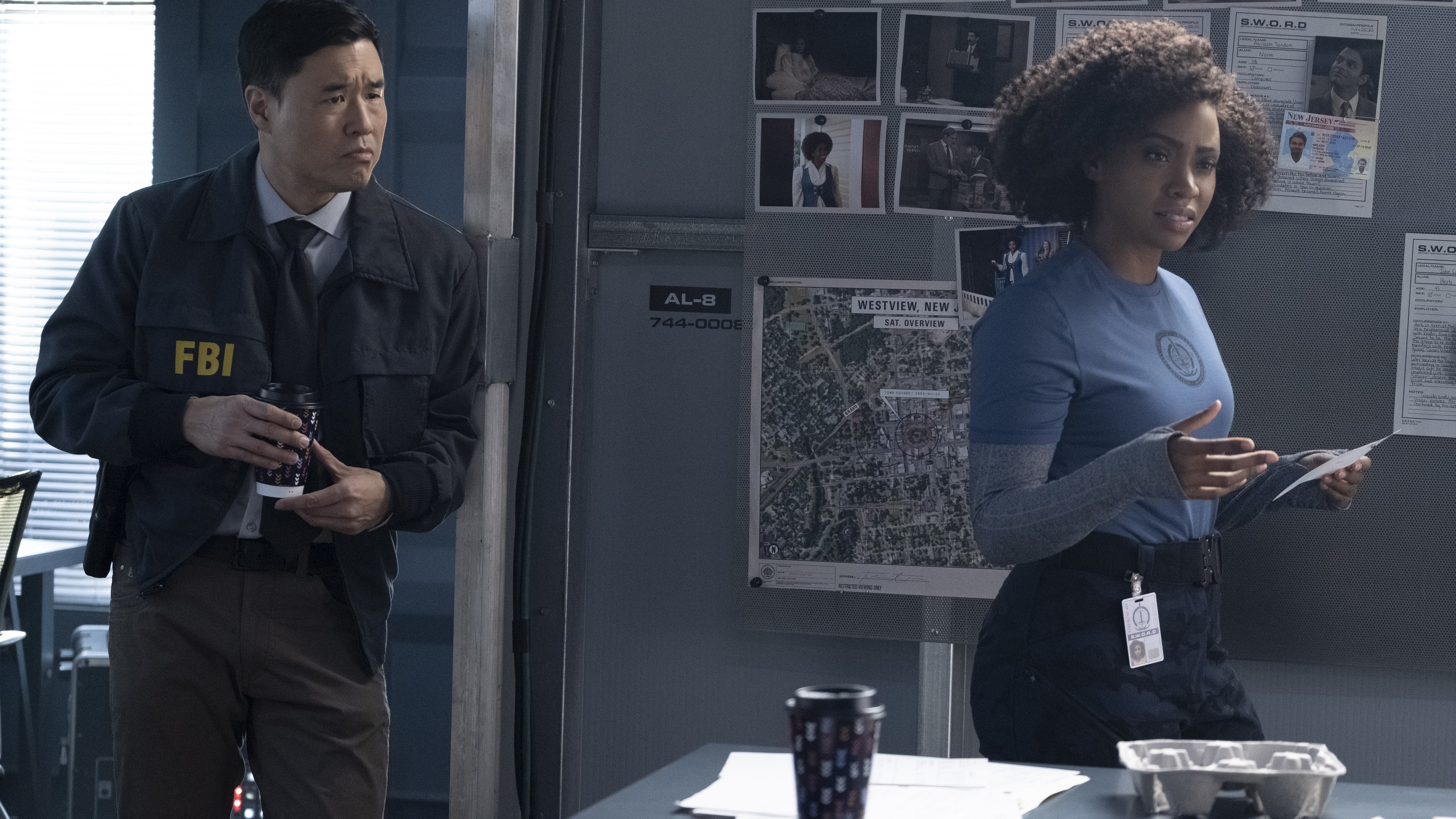 (L-R): Randall Park as Jimmy Woo and Teyonah Parris as Monica Rambeau in Marvel Studios' WANDAVISION exclusively on Disney+. Photo by Chuck Zlotnick. ©Marvel Studios 2021. All Rights Reserved.