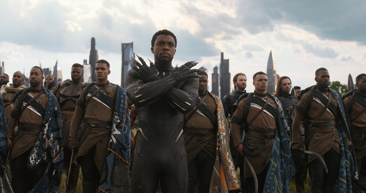 Black Panther, M'Baku, Captain America, and Winter Soldier stand together in Wakanda in a scene from Avengers: Infinity War.