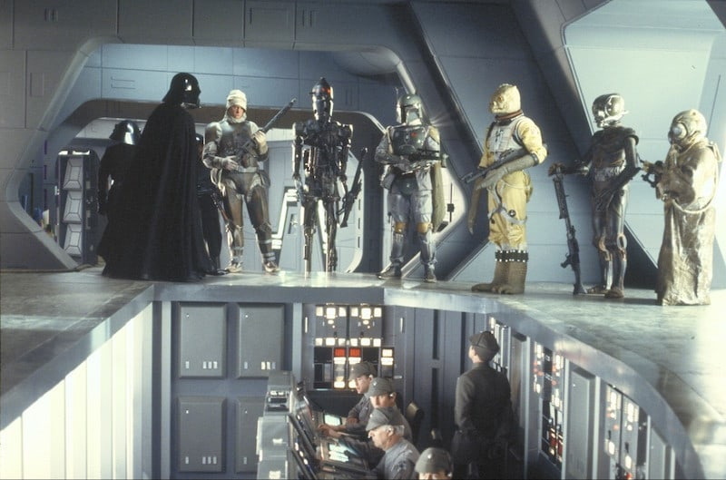 Bossk and other bounty hunters receiving a job from Darth Vader