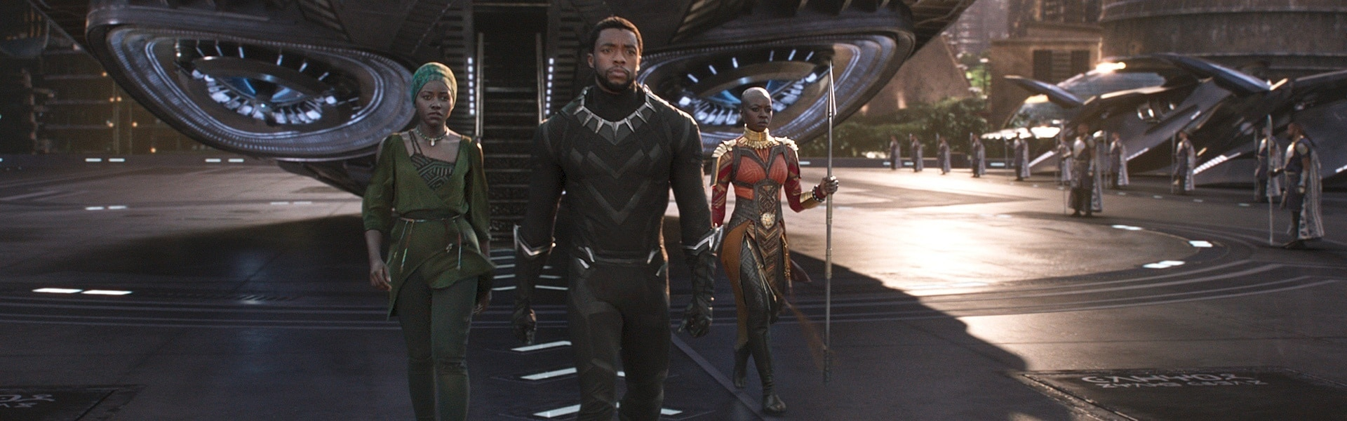 Black Panther, Nakia and Okoye walking in front of a spaceship in Wakanda