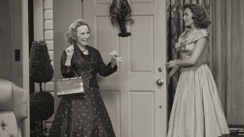 Debra Jo Rupp as Mrs. Hart and Elizabeth Olsen as Wanda Maximoff in Marvel Studios' WANDAVISION, exclusively on Disney+. Photo courtesy of Marvel Studios. ©Marvel Studios 2021. All Rights Reserved.