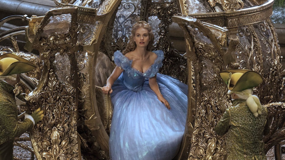 Actor Lily James (as Cinderella) stepping out of a carriage in the movie Cinderella.
