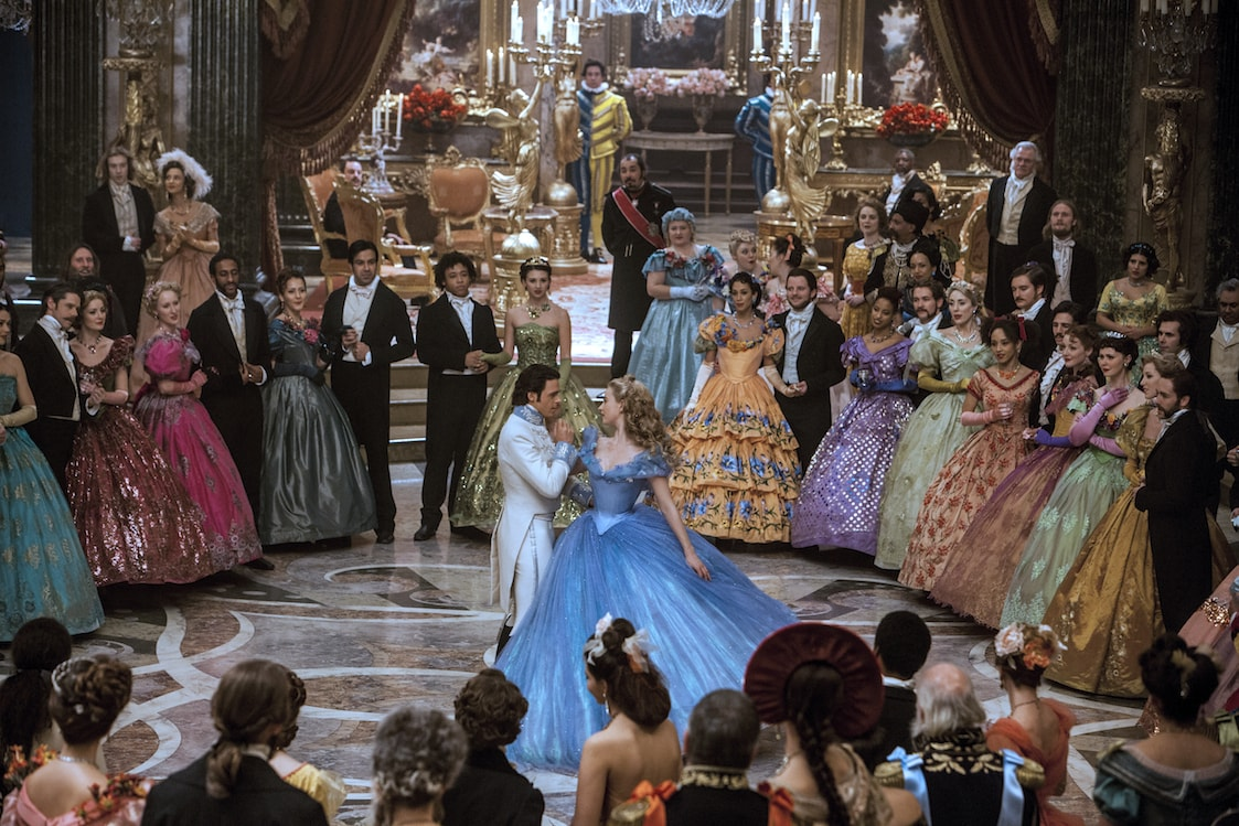 Actors Richard Madden (as the Prince) and Lily James (as Cinderella) dancing in the movie Cinderella.