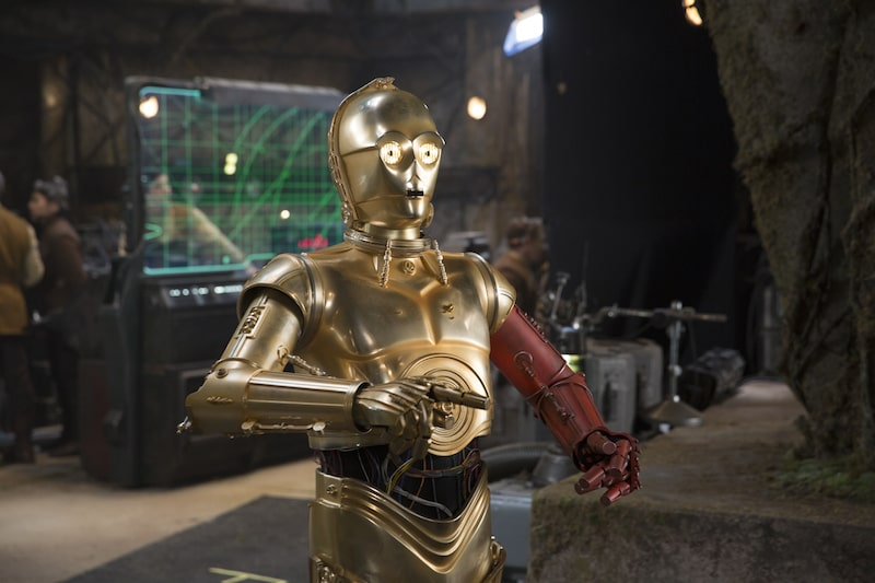 C-3PO receives a red arm