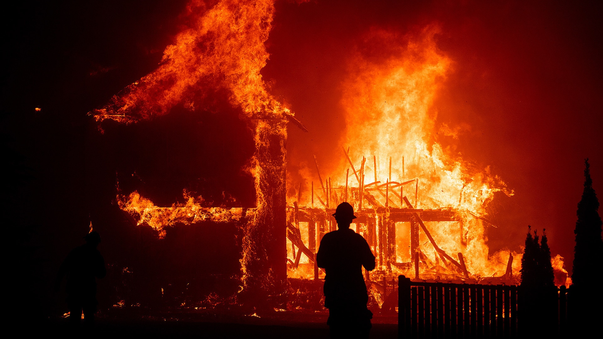 A home burns as the Camp Fire rages through Paradise, California, on Thursday, Nov. 8, 2018. (Photo by Noah Berger)