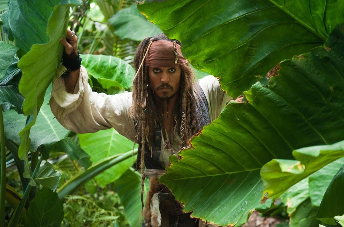 "Actor Johnny Depp as Captain Jack Sparrow in a jungle from the movie ""Pirates of the Caribbean"""