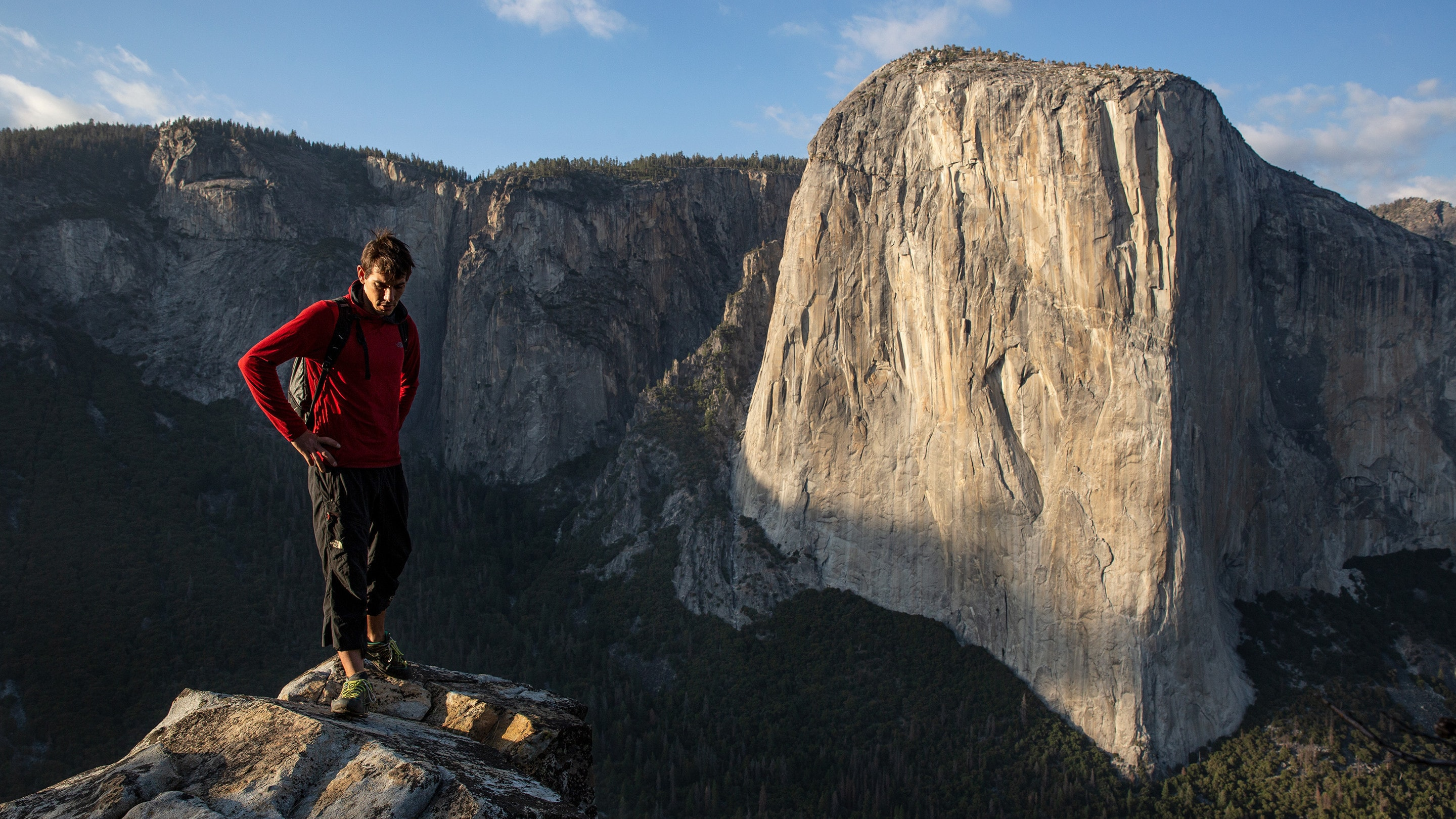 Alex Honnold on top of Lower Cathedral with El Capitan in the background, in Yosemite National Park, California. (Photo by National Geographic/Samuel Crossley)