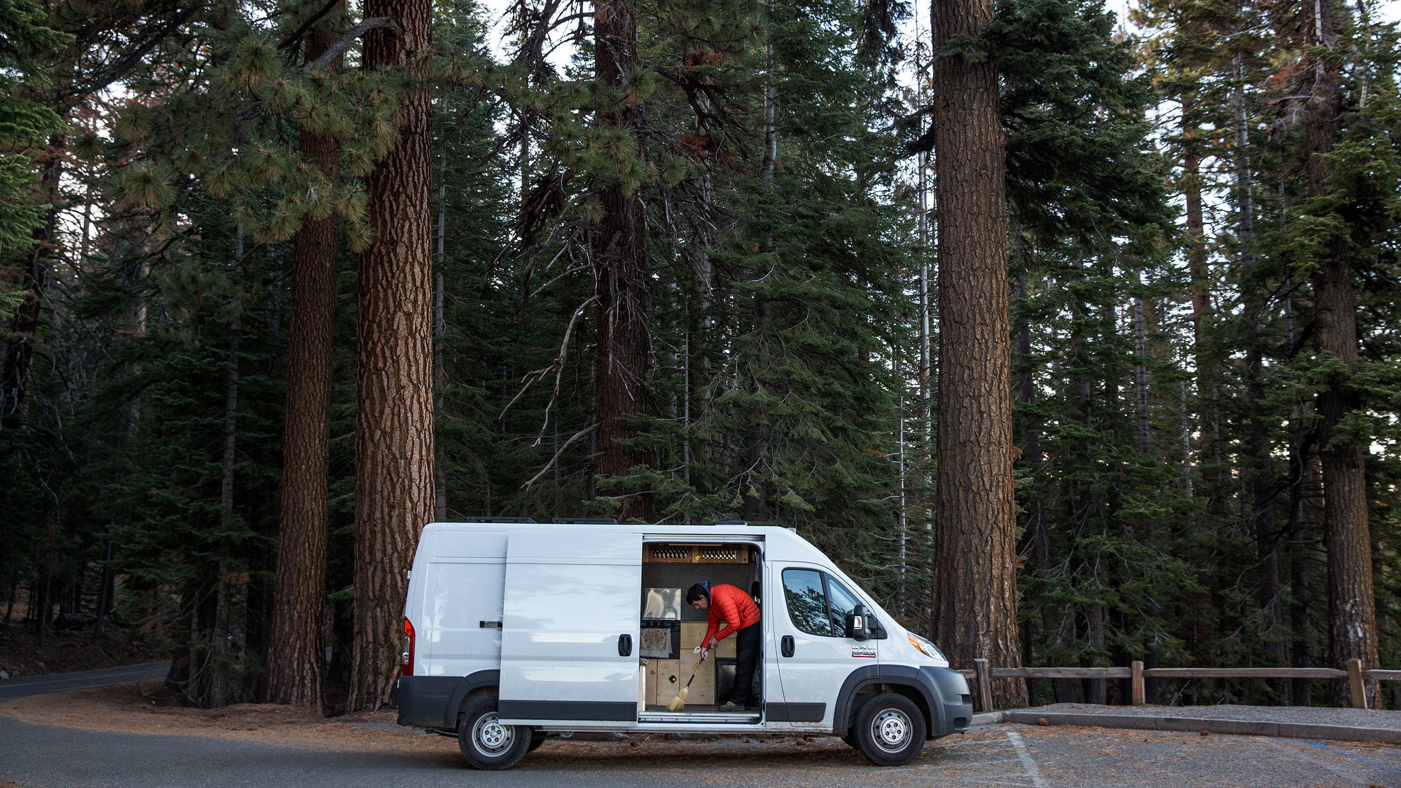 Alex Honnold cleaning his van in Yosemite National Park, California. (Photo by National Geographic/Jimmy Chin)