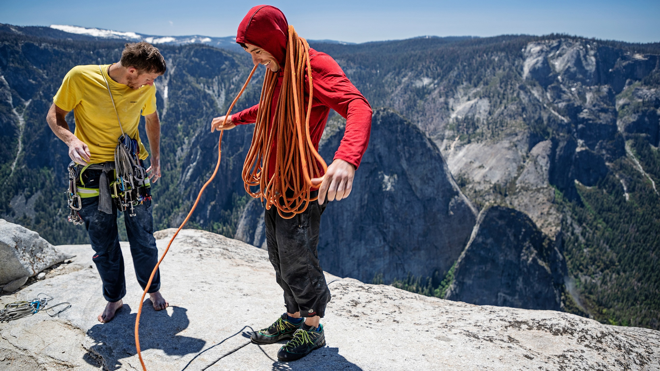 Alex Honnold and Tommy Caldwell organize their climbing gear at the top of the Freerider route on the summit of El Capitan in Yosemite National Park, California. They had just set a new speed record on the climb. (Photo by National Geographic/Jimmy Chin)