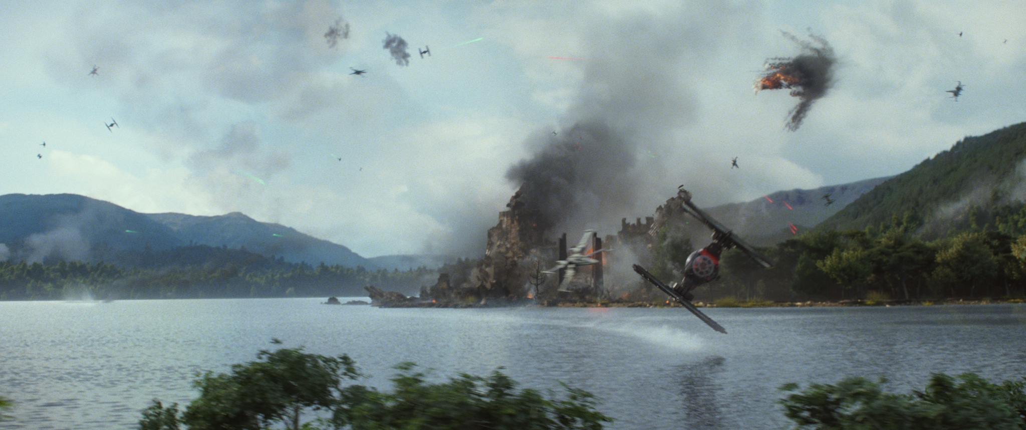 A TIE fighter zooms above water.