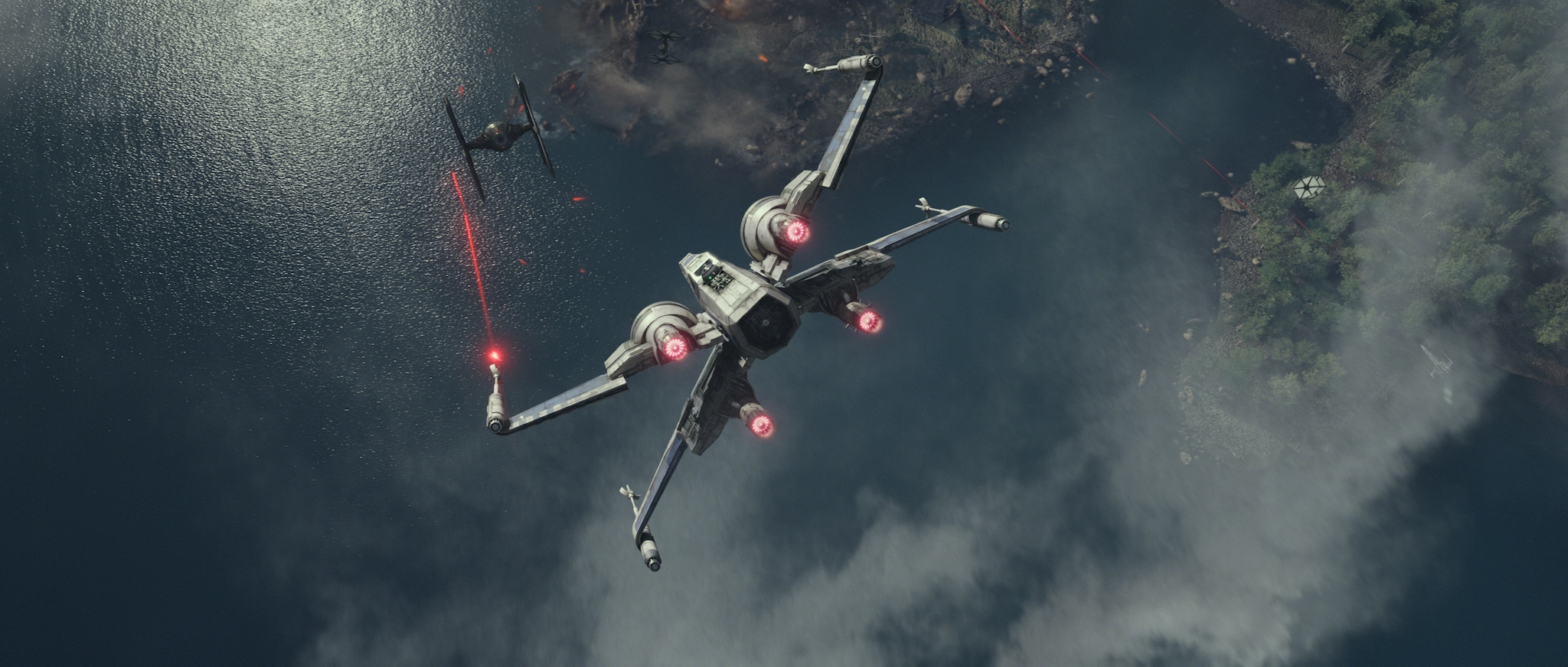 An X-wing (spacecraft) takes down a First Order TIE fighter.