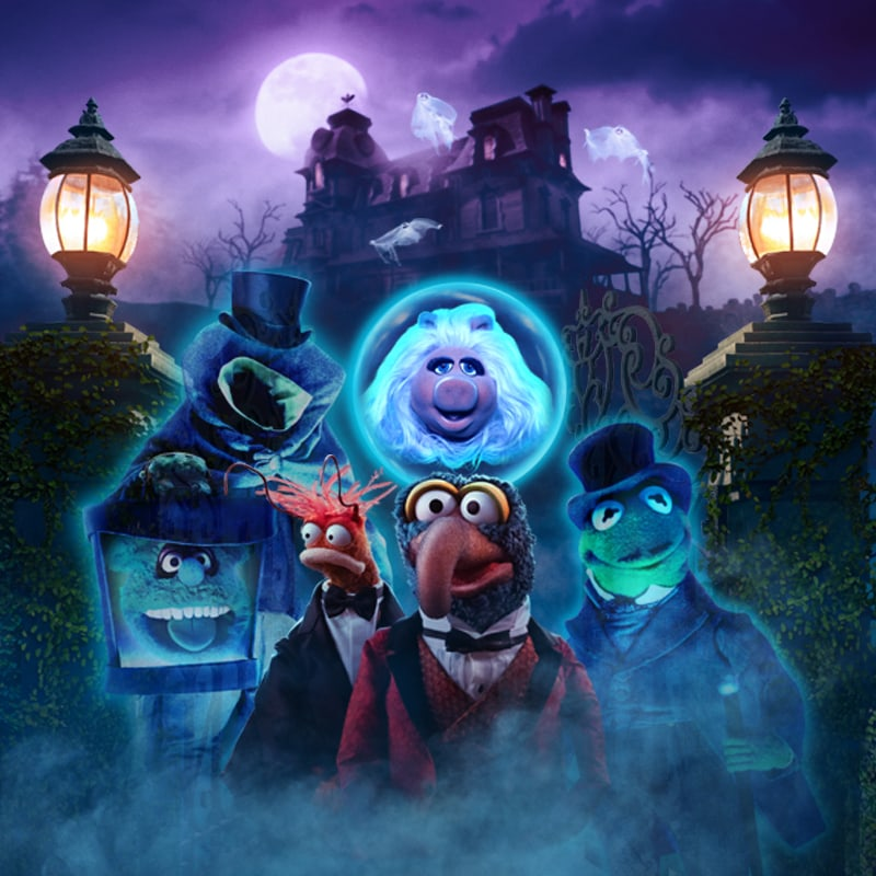 Muppets Haunted Mansion keyart featuring Miss Piggy, Gonzo, Kermit, Fozzie Bear, and Pepe the Prawn