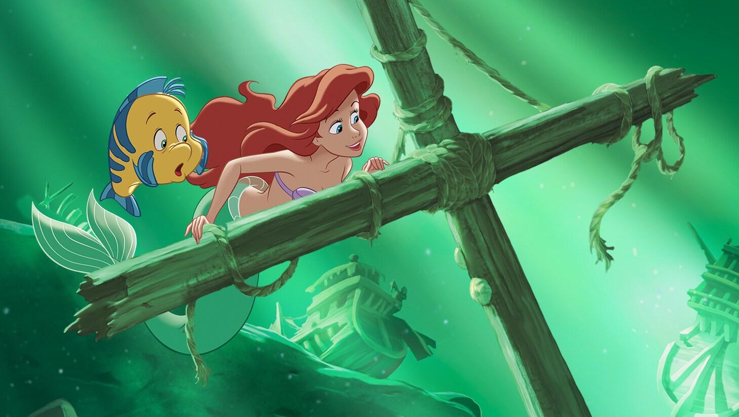 Ariel and Flounder explore a shipwreck