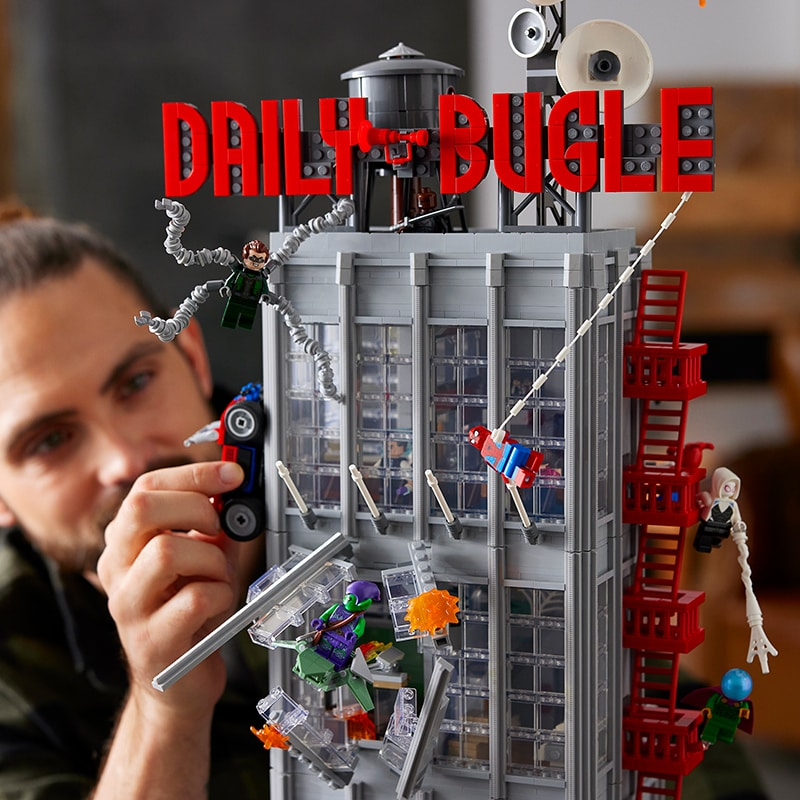 Model builds Lego Spider-Man Daily Bugle building