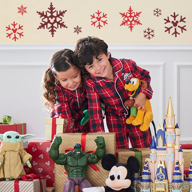 Two children pose with Disney-inspired toys