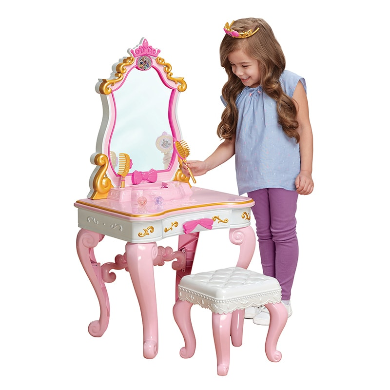 Child plays with Enchanted Messages Musical Vanity toy