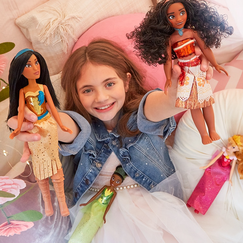 Model holds Hasbro Royal Shimmer Dolls