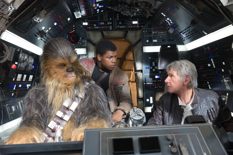 Chewbacca, Finn, and Han Solo in the cockpit of the Millennium Falcon
