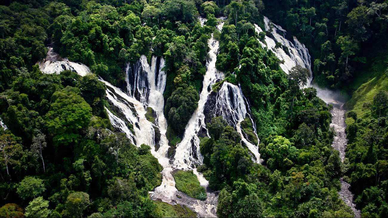 Majestic waterfalls pouring down a lush jungle mountain