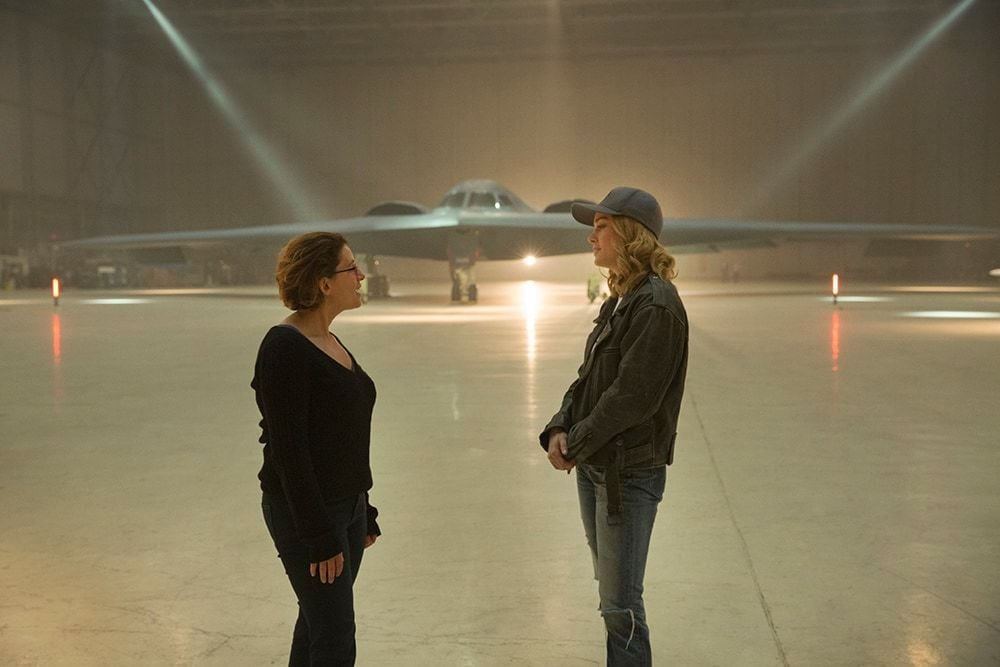 Anna Boden and Brie Larson (Captain Marvel) on set in front of Stealth Bomber Jet