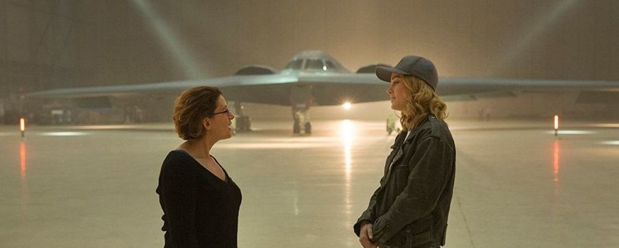 Anna Boden and Brie Larson in front of stealth bomber
