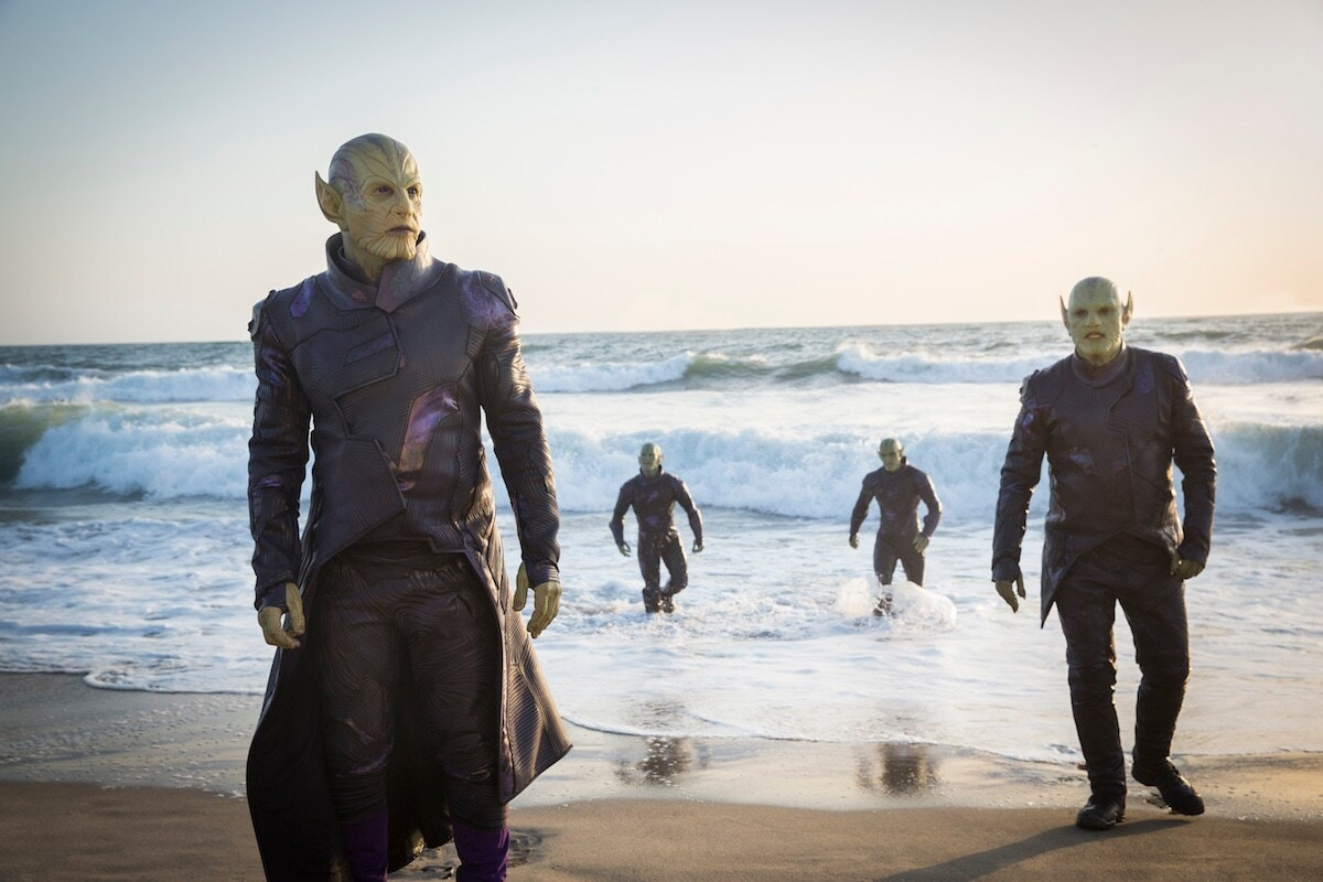 Green Skrull aliens emerging from a beach